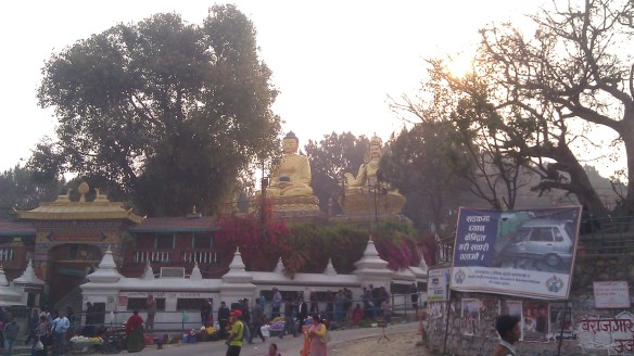 Passing some golden Buddhas on the walk in...